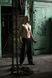 Muscular man and iron chains Stock Image