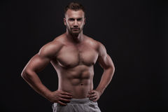 Muscular man isolated on black background Royalty Free Stock Photography