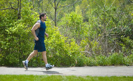 Muscular man jogging Stock Photography