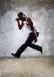 Muscular Man Jumping High Stock Images