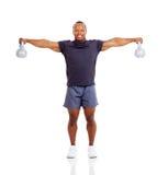 Muscular man kettle bells Stock Photos