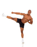 Muscular man kicking Royalty Free Stock Photos