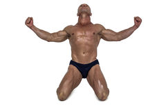 Muscular man kneeling down with arms outstretched Royalty Free Stock Photo