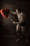 Muscular man with knife Stock Photography