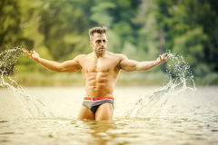 Muscular man lake Royalty Free Stock Image