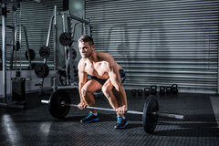Muscular man lifting a barbell Royalty Free Stock Photos