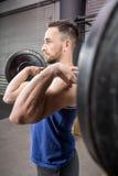 Muscular man lifting barbell Royalty Free Stock Photo