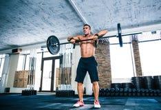 Muscular man lifting barbell Royalty Free Stock Photos