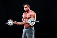 Muscular man lifting barbell Stock Photography