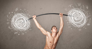 Muscular man lifting chaos concept Royalty Free Stock Images