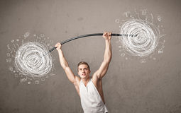 Muscular man lifting chaos concept Royalty Free Stock Image