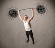 Muscular man lifting chaos concept Royalty Free Stock Photo