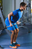 Muscular Man Lifting Deadlift In The Gym Stock Images