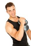 Muscular man lifting dumbbell royalty free stock photography