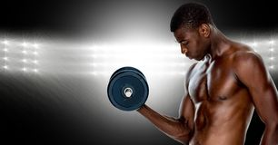 Muscular man lifting a dumbbell Royalty Free Stock Image
