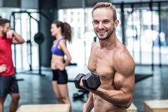 Muscular man lifting a dumbbell Stock Photo