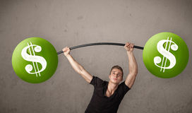 Muscular man lifting green dollar sign weights Stock Photos