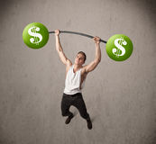 Muscular man lifting green dollar sign weights Stock Photo
