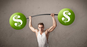 Muscular man lifting green dollar sign weights. Strong muscular man lifting green dollar sign weights royalty free stock photography