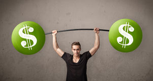 Muscular man lifting green dollar sign weights. Strong muscular man lifting green dollar sign weights royalty free stock images