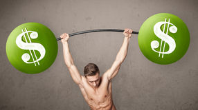 Muscular man lifting green dollar sign weights Stock Images
