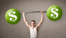 Muscular man lifting green dollar sign weights. Strong muscular man lifting green dollar sign weights royalty free stock image