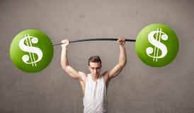 Muscular man lifting green dollar sign weights. Strong muscular man lifting green dollar sign weights royalty free stock photography