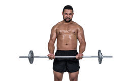 Muscular man lifting heavy barbell Royalty Free Stock Photo