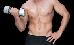 Muscular man lifting heavy dumbbell Royalty Free Stock Photography