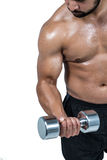 Muscular man lifting heavy dumbbell Stock Images