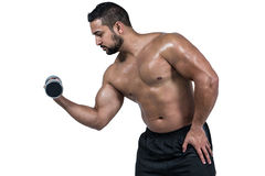 Muscular man lifting heavy dumbbell Stock Photo