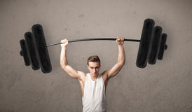 Muscular man lifting weights Royalty Free Stock Image