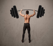 Muscular man lifting weights Royalty Free Stock Photo