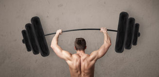 Muscular man lifting weights Stock Photo