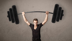 Muscular man lifting weights Stock Photography