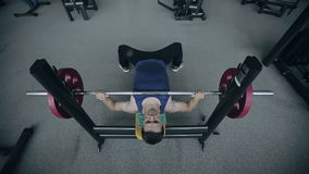 Muscular man lifts weights. Wide-angle lens shot stock footage