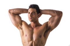 Muscular Man Looking Afar While Holding his Head Royalty Free Stock Photos