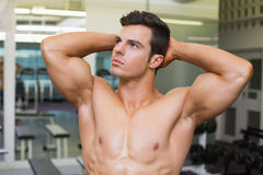 Muscular man looking away in gym Royalty Free Stock Image