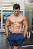 Muscular man looking down Royalty Free Stock Image