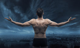 Muscular man looking at the town. Muscular man looking at the whole town Royalty Free Stock Images
