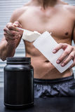 Muscular man making protein cocktail Stock Photography
