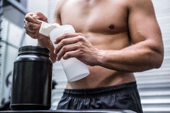 Muscular man making protein cocktail Stock Photo