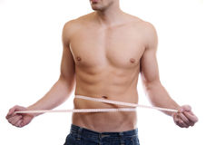 Muscular man measuing waist Royalty Free Stock Photography