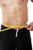 Muscular man measuring his belly. Stock Images