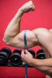 Muscular man measuring his muscles Stock Photo