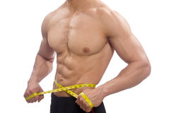 Muscular man measuring his muscles Royalty Free Stock Images