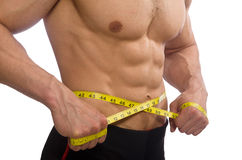 Muscular man measuring his muscles Royalty Free Stock Image