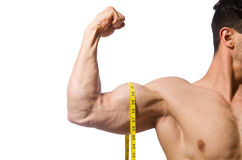 Muscular man measuring his muscles Stock Photography