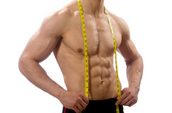 The muscular man measuring his muscles Royalty Free Stock Photos