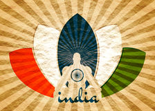 Muscular man meditation. Muscular man sit in meditation pose. Radiant rays. Cutout silhouette. Lotus Flower Painted by Indian Flags colors. Crumpled paper stock photos